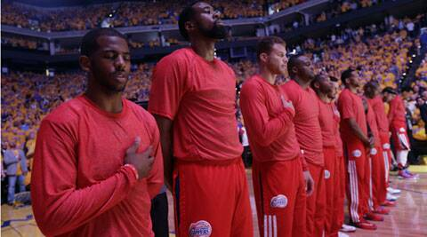 The LA Clippers team protested by wearing their training jerseys inside out to the hide the team's logo. They also donned black socks, armbands and wristbands. (AP)