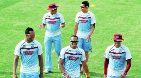 (From left) West Indies' Andre Russell, Krishmar Santokie, Dwayne Bravo, Sunil Narine and Samuel Badree attend a training session in Dhaka. Mystery bowlers Santokie and Narine, along with leg-spinner Badree, played a crucial role in West Indies' 84-run win on Tuesday. AP