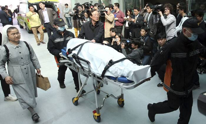 The families, who spent a mostly sleepless night at the hospital, followed the ambulances in their own cars. (AP)