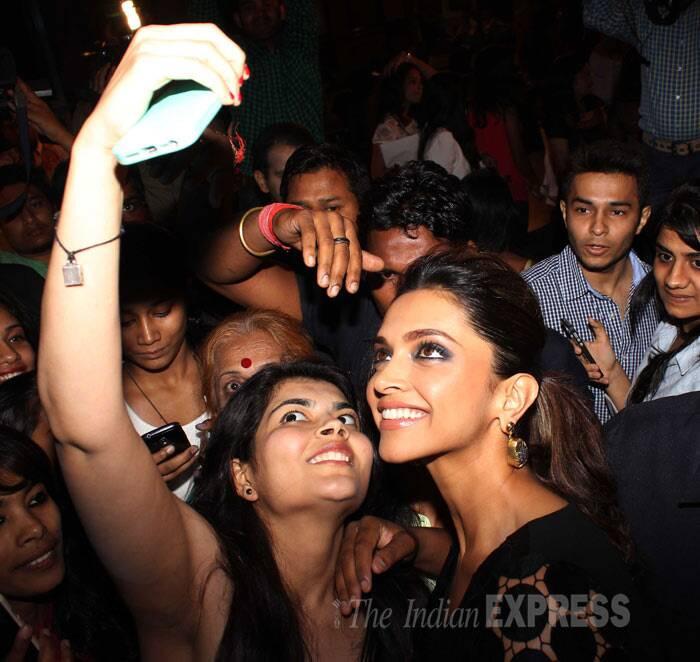 Selfie obsession contines - Deepika Padukone smiles for a selfie with a fan. (Photo: Varinder Chawla)