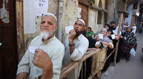 Voters queue up to cast their vote for Lok Sabha election in New Delhi on Thursday. (PTI)
