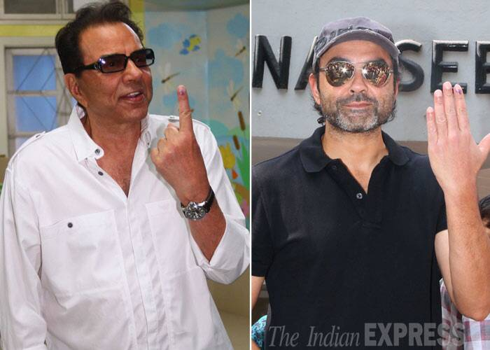 Veteran actor Dharmendra was accompanied by sons Sunny and Bobby Deol as they cast their vote early in the morning. (IE Photo: Amit Chakravarty)