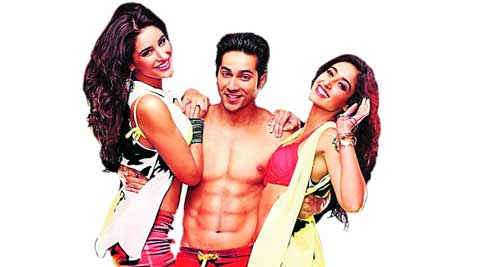 Muscle man to the rescue: Varun Dhawan poses with Ileana D'cruz and Nargis Fakhri