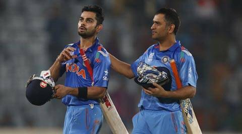 India's captain Mahendra Singh Dhoni pats teammate Virat Kohli after their win over South Africa (AP)