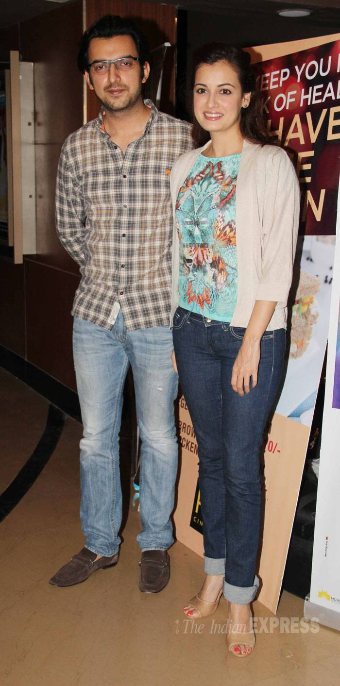 Dia Mirza, who has also turned producer with 'Bobby Jasoos', was casual in jeans, printed top and a cardigan. She was accompanied by her fiancé Sahil Sangha. (Photo: Varinder Chawla)