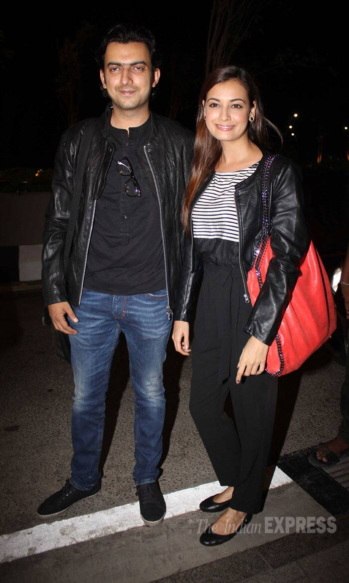 "Dia Mirza, who also cast her vote on April 24, wore a monochrome outfit as she posed for the camera along with fiancé Sahil Sangha. ""#IIFA2014 on our way to you #TampaBay yayyyy,"" tweeted the actress. (Photo: Varinder Singh)"