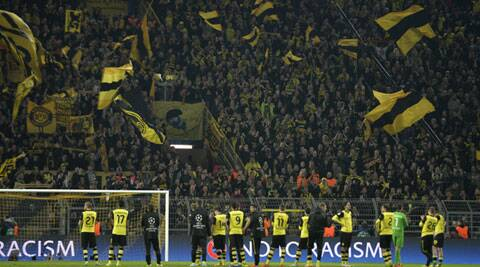 Dortmund's players stand in front of their supporters at the end of the Champions League quarterfinal second leg match between Borussia Dortmund and Real Madrid on Tuesday. (AP)