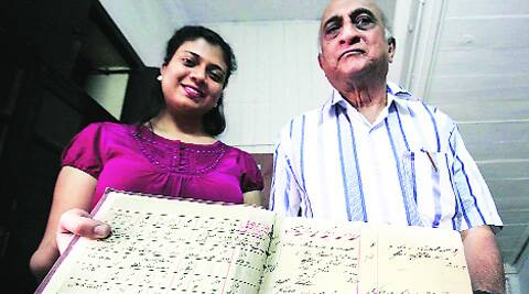 Raymond Soares and his daughter Sarina with the store logbook that has entries since 1908 . (Arul Horizon)