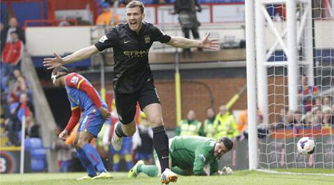 Manchester City's Edin Dzeko (center) celebrates after he scores a goal during their English Premier League match against Crystal Palace on Sunday. (AP)