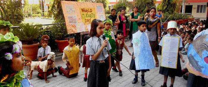 Earth Day is an annual event on which events are held worldwide to demonstrate support for environmental protection. <br />Students of JP Jain Sr. Secondary School performing on the occasion of Earth Day in their campus in Sonepat. (PTI)