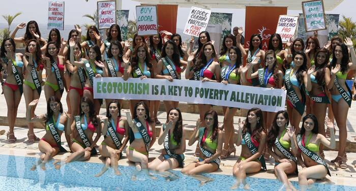 Contestants for the 2014 Miss Philippines Earth beauty pageant hold a banner during a press presentation in Manila. (Reuters)