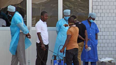 Medical personnel at the emergency entrance of a hospital receive suspected Ebola virus patients in Conakry, Guinea. (AP)