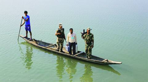 A polling official on his way to a booth in Lakhimpur constituency of Assam, Sunday. AP