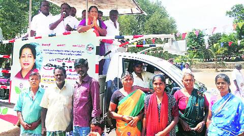Amma in the background, AIADMK candidate R Vanoraja poses with NREGA workers.Vinay Sitapati