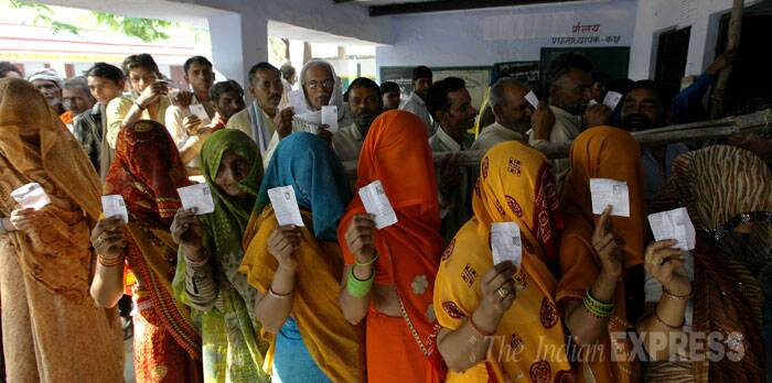 Women stand in a queue to cast their votes in Mathura during the sixth phase of polling on Thursday. (IE Photo: Ravi Kanojia)