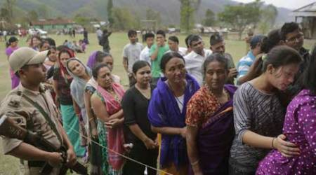 People stand in line to cast their votes at a voting center in Kalapahar, Manipur. (PTI Photo)