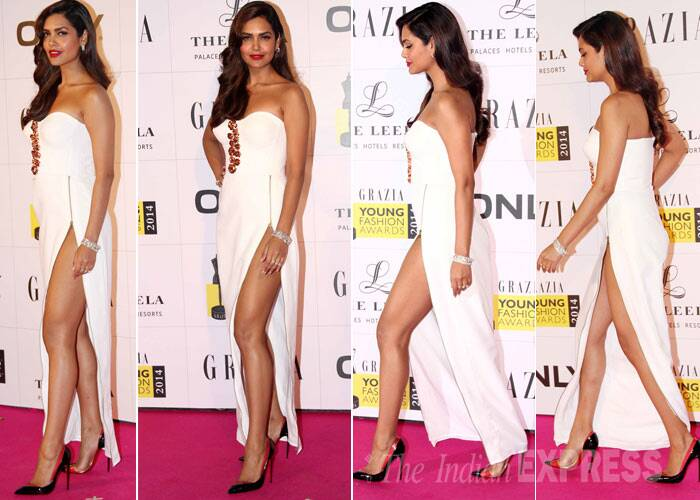 Former Kingfisher model and actress Esha Gupta stole the show at the award show in her risque white Nikhil Thampi strapless gown. The gown with a dangerously high slit showed off her perfectly toned legs. She left her hair in soft curls and the cherry on the cake was her red lip colour. Superlike! (Photo: Varinder Chawla)