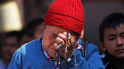 Mother of Nepalese mountaineer Ang Kaji Sherpa, killed in an avalanche on Mount Everest, holds prayers beads in her hand and cries while she waits for his body at Sherpa Monastery in Katmandu, Nepal. (AP)