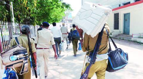 EVMs being carried to a booth in Gaya on Wednesday.PTI