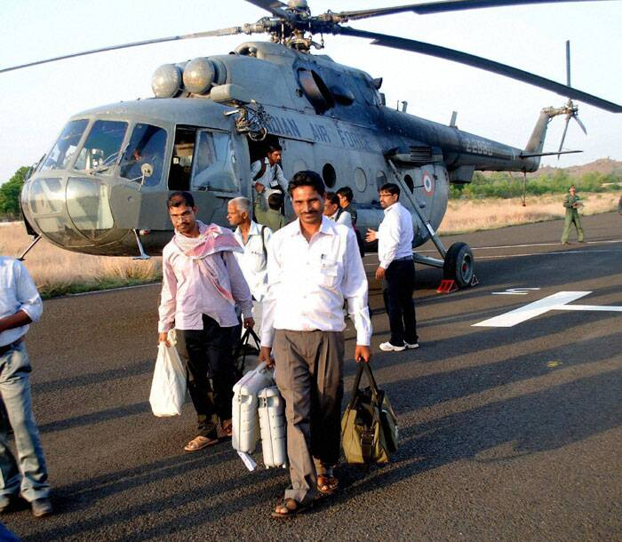 Poll officials return with EVMs by helicopter from naxal hit area of Dumka Lok Sabha election on Thursday.  (PTI)
