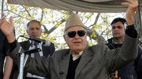 Union Minister and Parliamentary Candidate Farooq Abdullah addresses an election rally after a grenade hurled by militants,at Magam in district on Sunday. (PTI)