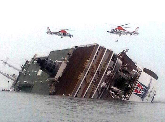 Strong currents, rain and bad visibility hampered an increasingly anxious search Thursday for 287 passengers still missing a day after their ferry flipped onto its side and filled with water off the southern coast of South Korea. (AP)