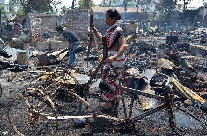 Residents salvage their belonging after a fire gutted down many residential houses at Signal Bosti in Dimapur, Nagaland on Saturday. (PTI)