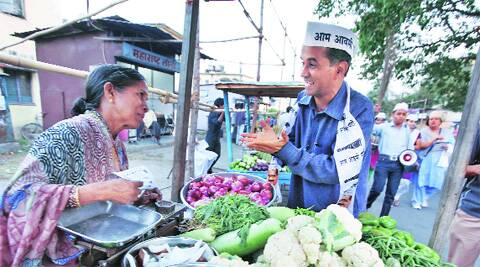 AAP candidate Subhash Ware talks to a vegetable seller. (Photo: Sandeep Daundkar)