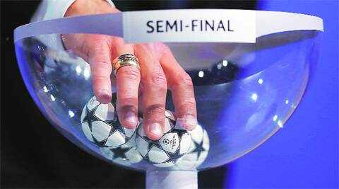 Luis Figo makes the draw for the Champions League semi-finals matches.(Reuters)