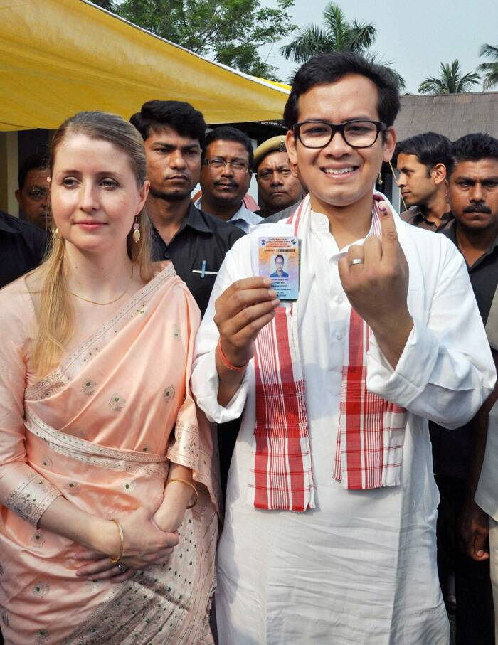 Congress candidate for Kaliabor Lok Sabha Constituency Gaurav Gogoi shows his mark after casting his vote at a polling station in Jorhat district of Assam. (PTI)