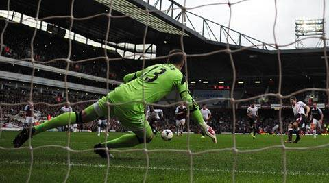 Liverpool's Steven Gerrard (2nd R) shoots to score a penalty during their English Premier League soccer match against West Ham United at Upton Park in London (Reuters)