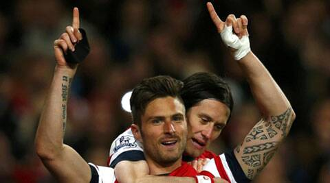 Arsenal's Olivier Giroud (front) celebrates with teammate Tomas Rosicky after scoring a goal against West Ham United during their English Premier League match on Tuesday. (Reuters)