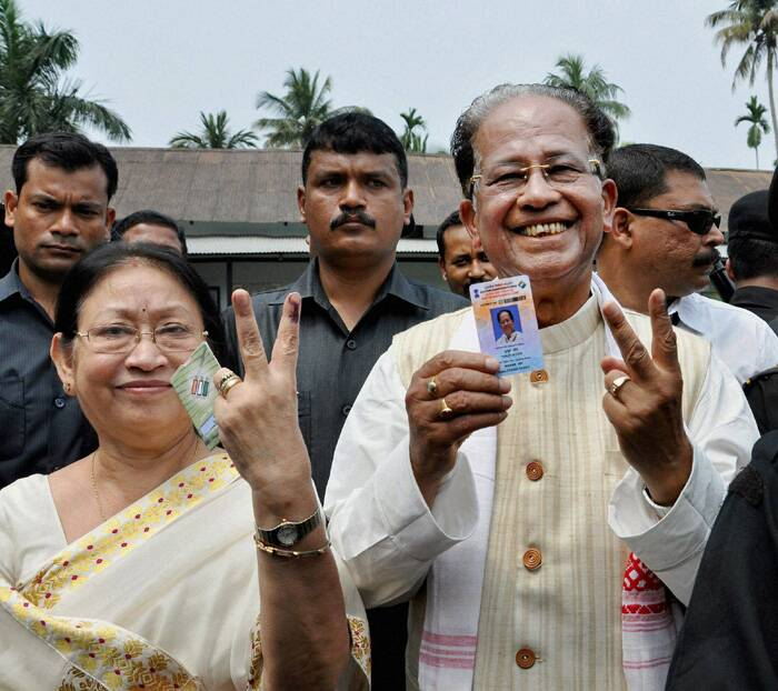 Chief Minister of Assam Tarun Gogoi with his wife Dolly Gogoi showing their mark after casting their vote at Jorhat district of Assam. (PTI)