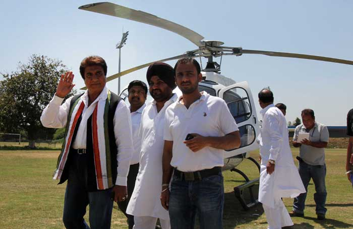 Congress leader Raj Babber being escorted by party workers on Thursday. (IE Photo: Gurmeet Singh)