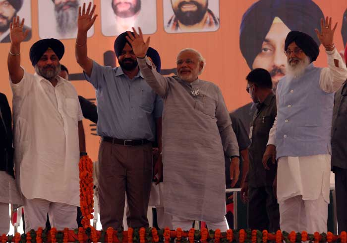 BJP's prime ministerial candidate Narendra Modi with the Punjab chief minister Parkash Singh Badal (right), deputy chief minister Sukhbir Badal (left) and BJP's Ludhiana candidate Manpreet Ayali (2nd from left) at an election rally in Ludhiana on Friday, (IE Photo: Gurmeet Singh)
