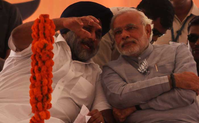 Punjab's deputy CM Sukhbir Badal with BJP's prime ministerial candidate Narendra Modi at an election rally in Ludhiana on Friday. (IE Photo: Gurmeet Singh)