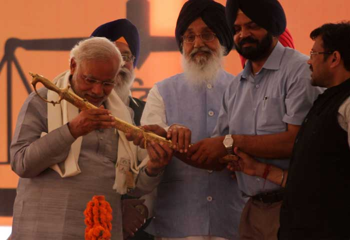 Narendra Modi is presented a 'Kirpan' (sword) during an election rally in Ludhiana. (IE Photo: Gurmeet Singh)