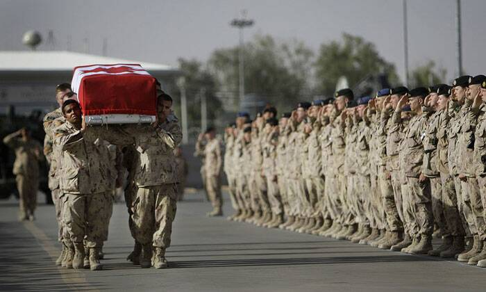 Comrades of fallen Canadian trooper Larry Rudd carry his casket onto a plane during a ramp ceremony at Kandahar Airfield, on May 26, 2010. Rudd, 26, was the 146th member of the Canadian military to die in Afghanistan since the U.S.-led invasion in 2001. (AP Photo/Anja Niedringhaus)