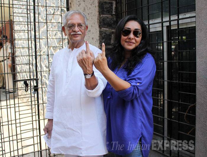 Veteran film lyricist and director Gulzar who was recently chosen for Dadasaheb Phalke Award displayed his inked finger along with daughter Meghna after casting their votes in Mumbai. (IE Photo: Varinder Chawla)
