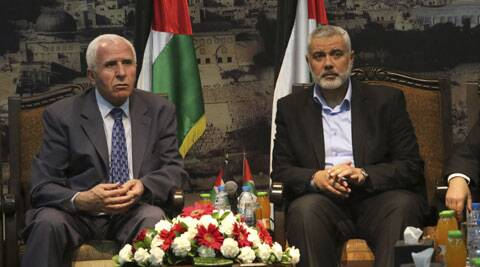 Gaza's Hamas Prime Minister Ismail Haniyeh, right, and senior Fatah official Azzam al-Ahmad meet in Gaza for talks aimed at reaching a reconciliation agreement between the two rival Palestinian groups. (AP)