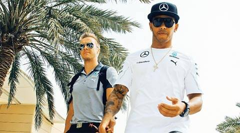 British Formula One driver Lewis Hamilton of Mercedes AMG Petronas, right, arrives at the circuit ahead of the Bahrain Formula One Grand Prix (AP)