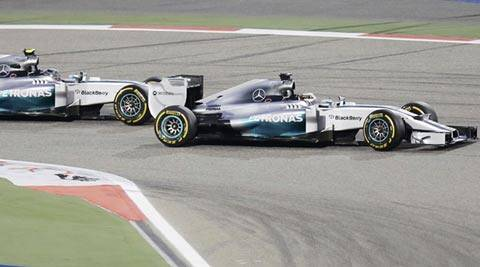 Mercedes' Rosberg and Hamilton were neck-and-neck before the Britain won his second race of the season (Reuters)