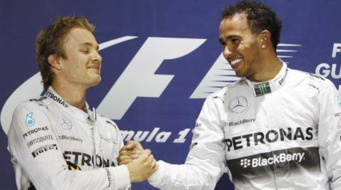 Mercedes Formula One driver Lewis Hamilton of Britain (R) is congratulated by teammate Mercedes Formula One driver Nico Rosberg of Germany on the podium after he won the Bahrain F1 Grand Prix (Reuters)