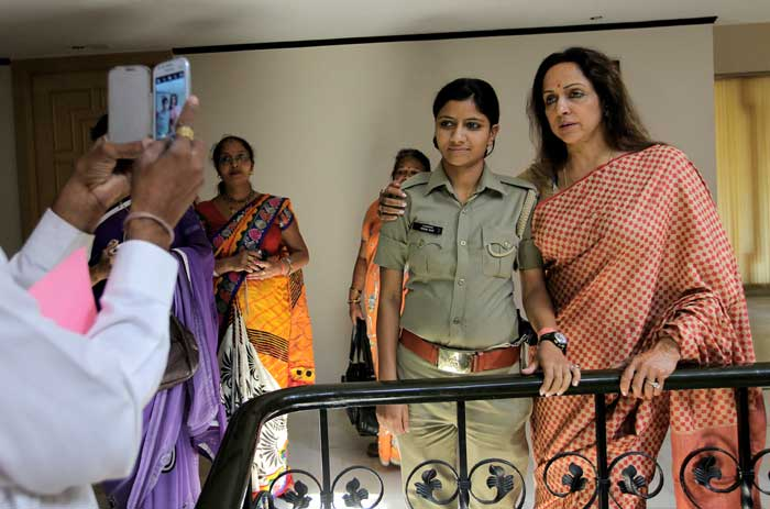 Hema Malini and poll staff get clicked a day before polling. (Express photo: Ravi Kanojia)