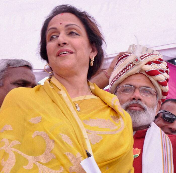 BJP candidate Bollywood actress Hemamalini with a supporter dressed up as Narendra Modi during her election campaign in Mathura. (PTI)