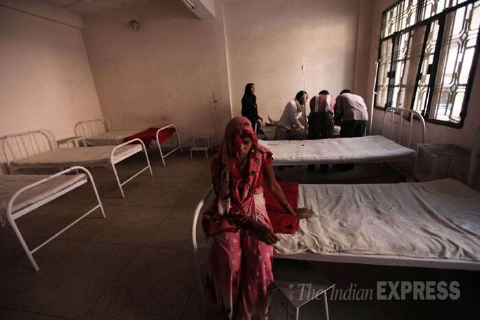 A patient waits for treatment at the only government hospital in Sambhal. (IE Photo: Tashi Tobgyal)