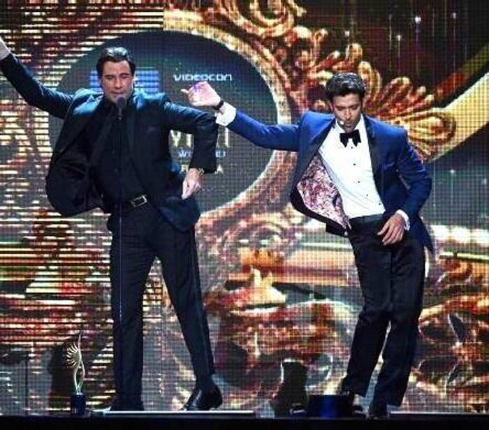 John Travolta, who was honoured for his outstanding contribution to International cinema by Hrithik Roshan, danced to the tunes of Travolta's famous 'Staying Alive' dance number. (Photo: Twitter)