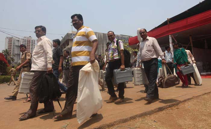 Poll officers step out of the polling center at Navi Mumbai. (Express photo: Deepak Joshi)