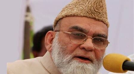 Shahi Imam of Delhi's Jama Masjid Maulana Syed Ahmed Bukhari addresses a press conference at the mosque in New Delhi on Friday. (PTI)