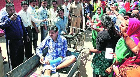 Nothing can stop them: An injured voter coming out from a polling station at Dadumajra on Thursday. Kamleshwar Singh